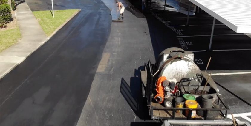 Asphalt Company working on a parking lot paving project in Pinellas County, Fl